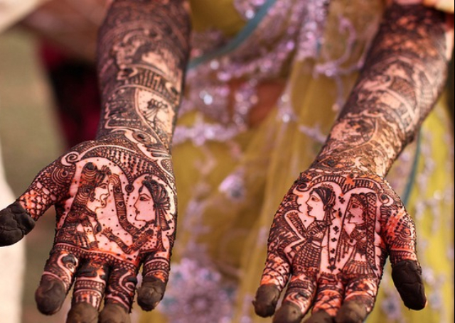 Bridal Mehandi Design featuring exquisite Dulha Dulhan pattern