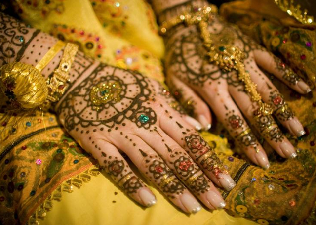 Bridal Mehandi Design with sparkles and floral motifs