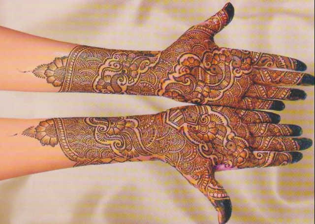 Bridal Mehandi Design focusing on a peacock pattern