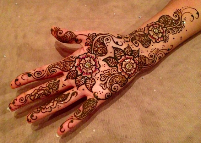 Bridal Mehandi Design featuring multiple patterns highlighted with glitter