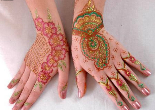 Colorful Bridal Mehandi Design featuring flowers and ambi