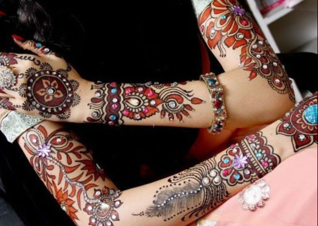 Latest Arabic Mehandi Design with colored stones and bold patterns on arms