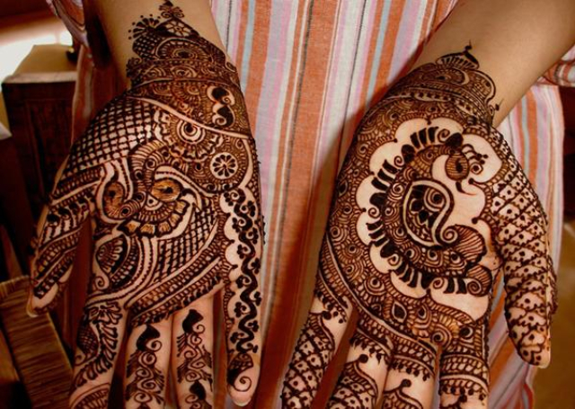 Latest Mehandi Bridal Design featuring peacock motif