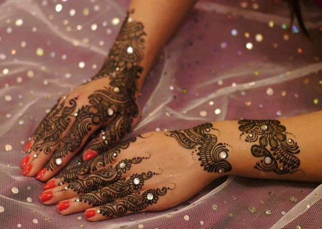 Latest Mehandi Bridal Design bedecked with stones and glitter