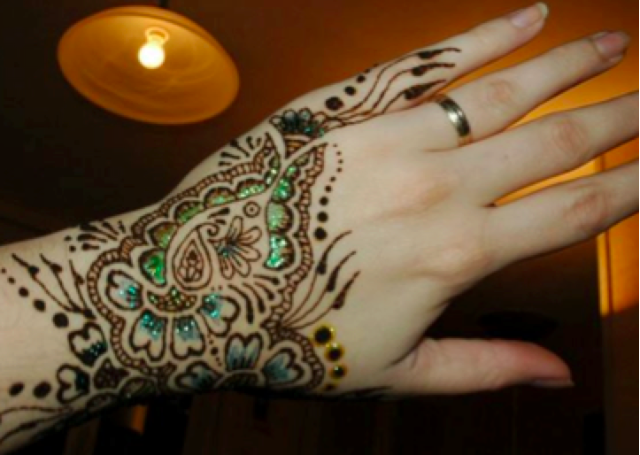 Floral mehendi with colourful embellishments
