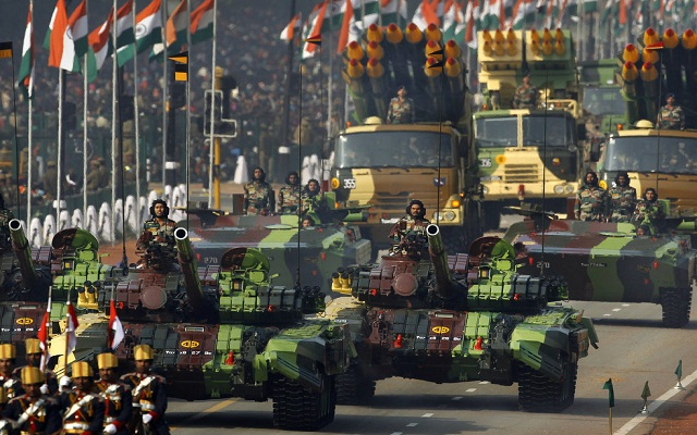 Indian army soldiers ride on T-72 tanks on Rajpath during the main Republic Day parade in New Delhi, Thursday, Jan. 26, 2012. India is marking it's 62nd Republic Day with military parades across the country. (AP Photo/Kevin Frayer)